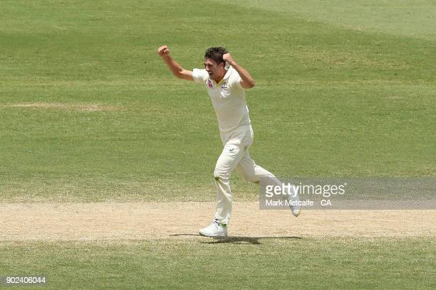 Pat Cummins of Australia celebrates taking the wicket of Mason Crane of England during day five of the Fifth Test match in the 2017/18 Ashes Series...