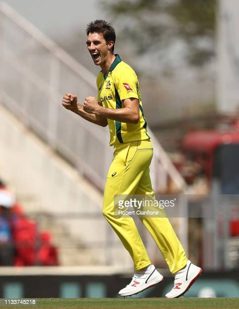 Pat Cummins of Australia celebrates taking the wicket of Rohit Sharma of India during game two of the One Day International series between India and...
