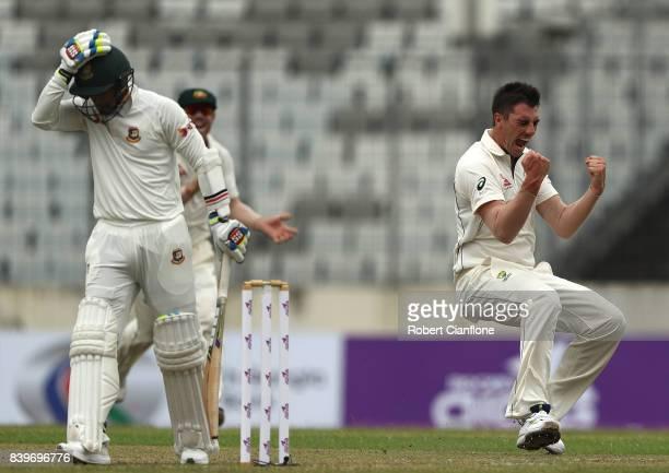 Pat Cummins of Australia celebrates taking the wicket of Shabbir Rahman Roman of Bangladesh during day one of the First Test match between Bangladesh...