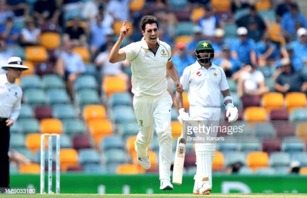 Pat Cummins of Australia celebrates taking the wicket of Shan Masood of Pakistan during day one of the 1st Domain Test between Australia and Pakistan...