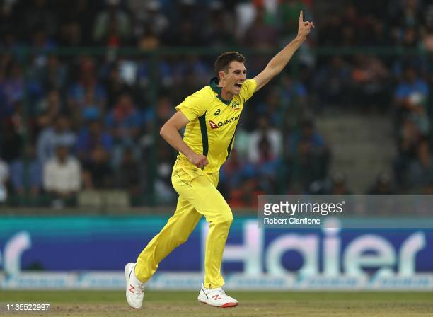 Pat Cummins of Australia celebrates taking the wicket of Shikhar Dhawan of India during game five of the One Day International series between India...