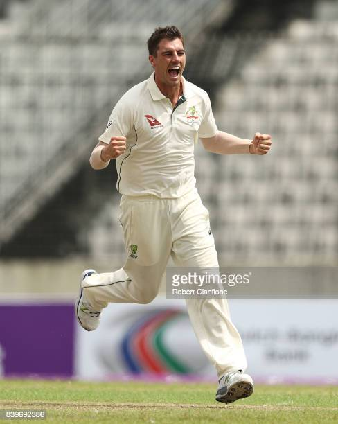 Pat Cummins of Australia celebrates taking the wicket of Soumya Sarker of Bangladesh during day one of the First Test match between Bangladesh and...