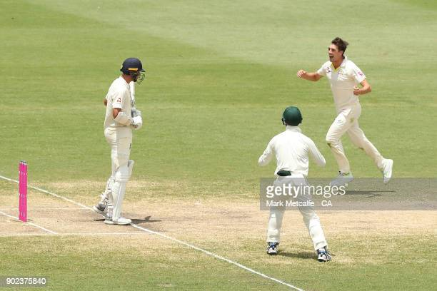 Pat Cummins of Australia celebrates taking the wicket of Stuart Broad of England during day five of the Fifth Test match in the 2017/18 Ashes Series...