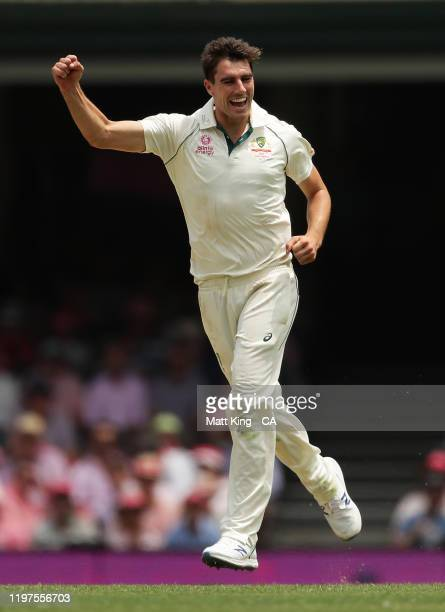 Pat Cummins of Australia celebrates taking the wicket of Tom Latham of New Zealand during day three of the Third Test match in the series between...