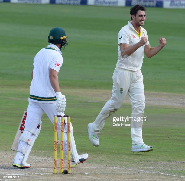 Pat Cummins of Australia celebrates the wicket of AB de Villiers of the Proteas during day 3 of the 4th Sunfoil Test match between South Africa and...