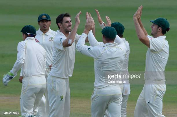 Pat Cummins of Australia celebrates the wicket of AB de Villiers of the Proteas with his team mates during day 3 of the 4th Sunfoil Test match...