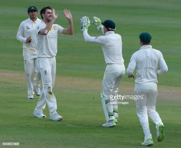 Pat Cummins of Australia celebrates the wicket of AB de Villiers of the Proteas with Tim Paine of Australia during day 3 of the 4th Sunfoil Test...