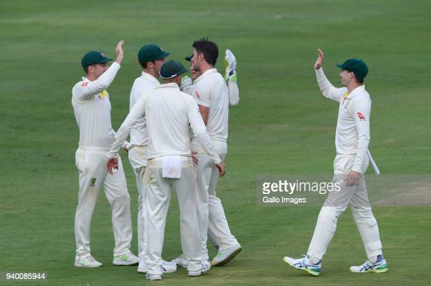 Pat Cummins of Australia celebrates the wicket of Aiden Markram of the Proteas with his team mates during day 1 of the 4th Sunfoil Test match between...