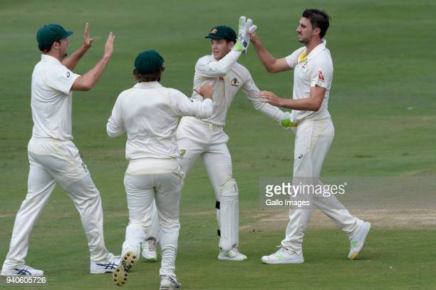 Pat Cummins of Australia celebrates the wicket of Aiden Markram of the Proteas with his team mates during day 3 of the 4th Sunfoil Test match between...