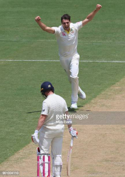 Pat Cummins of Australia celebrates the wicket of Mark Stoneman of England day one of the Fifth Test match in the 2017/18 Ashes Series between...