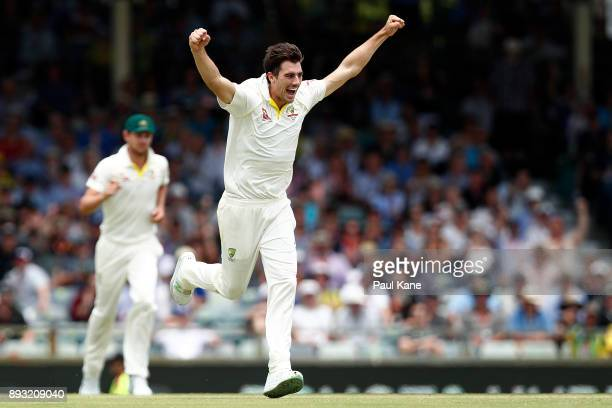 Pat Cummins of Australia celebrates the wicket of Moeen Ali of England during day two of the Third Test match during the 2017/18 Ashes Series between...