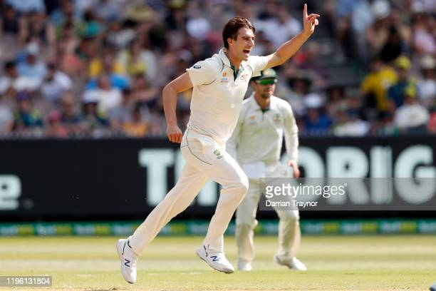 Pat Cummins of Australia celebrates the wicket of Tom Blundell of New Zealandduring day two of the Second Test match in the series between Australia...