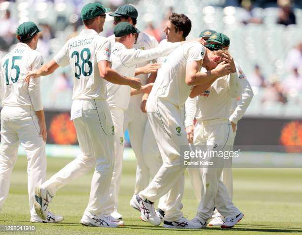 Pat Cummins of Australia celebrates with Cameron Green of Australia after taking a catch to dismiss Virat Kohli of India during day three of the...