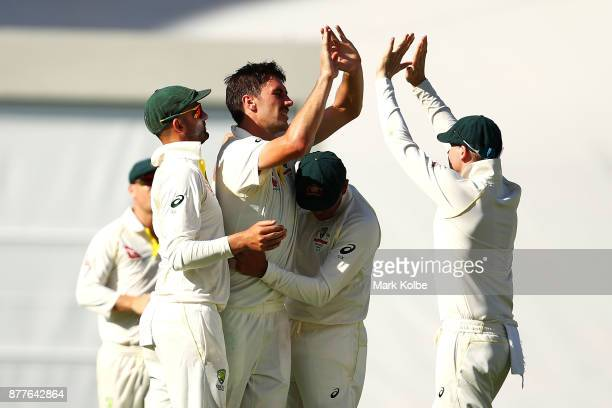 Pat Cummins of Australia celebrates with his team mates after taking the wicket of Mark Stoneman of England during day one of the First Test Match of...