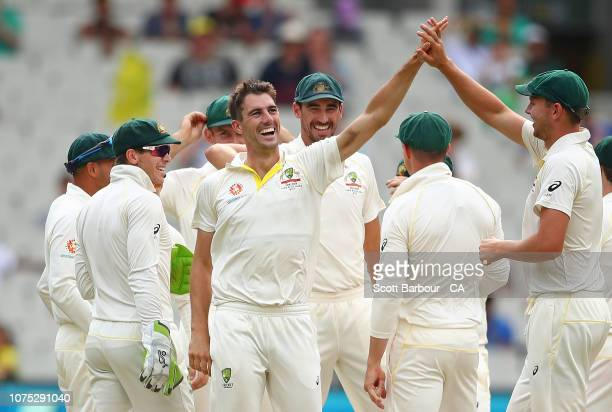 Pat Cummins of Australia celebrates with Josh Hazlewood Mitchell Starc and Tim Paine after dismissing Ajinkya Rahane of India during day three of the...