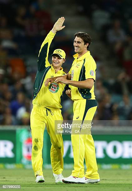 Pat Cummins of Australia celebrates with Steve Smith of Australia after taking the wicket of Kane Williamson of New Zealand during game two of the...