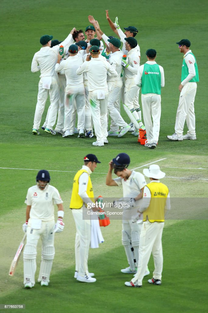 Pat Cummins of Australia celebrates with team mates after dismssing Joe Root of England for lbw following a review during day one of the First Test Match of the 2017/18 Ashes Series between Australia and England at The Gabba on November 23, 2017 in Brisbane, Australia.