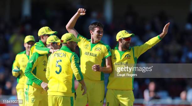 Pat Cummins of Australia celebrates with team mates after taking the wicket of Shai Hope during the Group Stage match of the ICC Cricket World Cup...