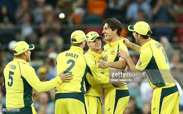Pat Cummins of Australia celebrates with team mates after taking the wicket of Martin Guptill of New Zealand during game two of the One Day...