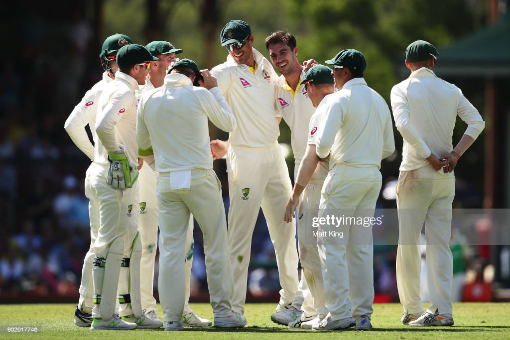 Pat Cummins of Australia celebrates with team mates after taking the wicket of James Vince of England during day four of the Fifth Test match in the 2017/18 Ashes Series between Australia and England at Sydney Cricket Ground on January 7, 2018 in Sydney, Australia.