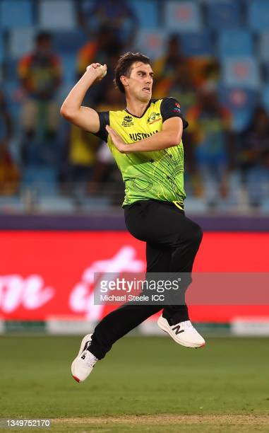 Pat Cummins of Australia in bowling action during the ICC Men's T20 World Cup match between Australia and Sri Lanka at Dubai International Stadium on...