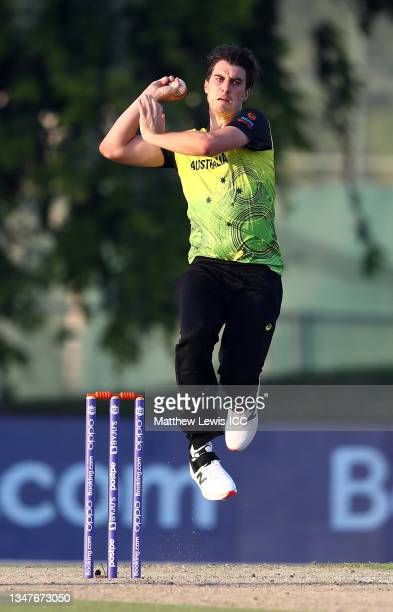 Pat CUmmins of Australia in bowling action during the India and Australia warm Up Match prior to the ICC Men's T20 World Cup at on October 20, 2021...
