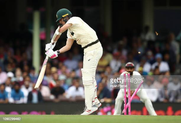 Pat Cummins of Australia is bowled by Mohammed Shami of India during day four of the Fourth Test match in the series between Australia and India at...