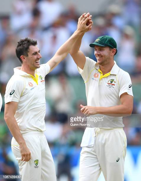 Pat Cummins of Australia is congratulated by Josh Hazlewood getting the wicket of Ajinkya Rahane of India during day three of the Third Test match in...
