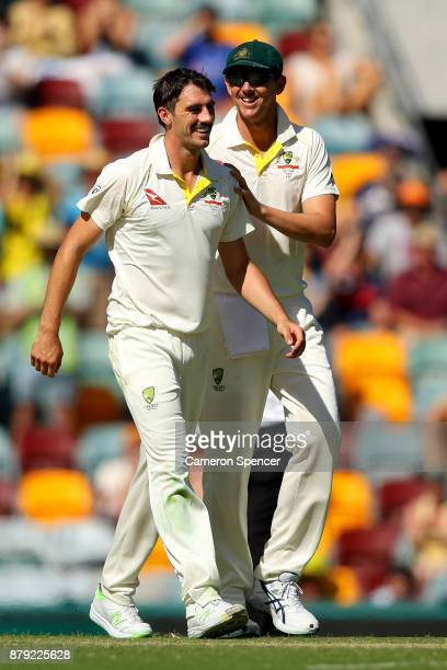 Pat Cummins of Australia is congratulated by Josh Hazlewood of Australia after dismissing Jake Ball of England during day four of the First Test...