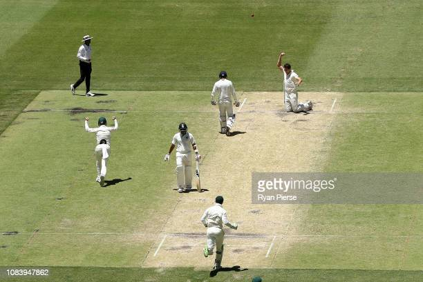Pat Cummins of Australia takes a catch off his own bowling to dismiss Jasprit Bumrah of India and claim victory during day five of the second match...