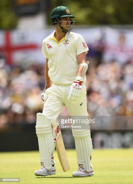 Pat Cummins of Australia walks off the field after being dismissed during day four of the Third Test match during the 2017/18 Ashes Series between...