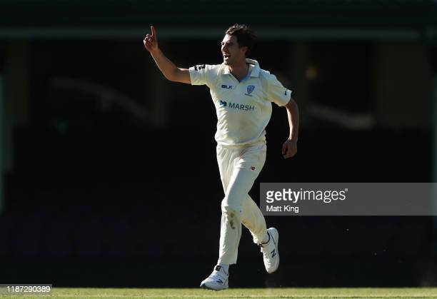 Pat Cummins of the Blues celebrates taking the wicket of Josh Philippe of the Warriors during day three of the Sheffield Shield match between New...