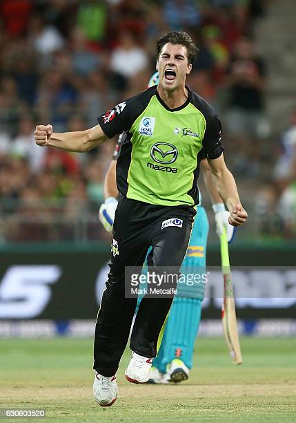 Pat Cummins of the Thunder celebrates after taking the wicket of Brendon McCullum of the Heat during the Big Bash League match between the Sydney...