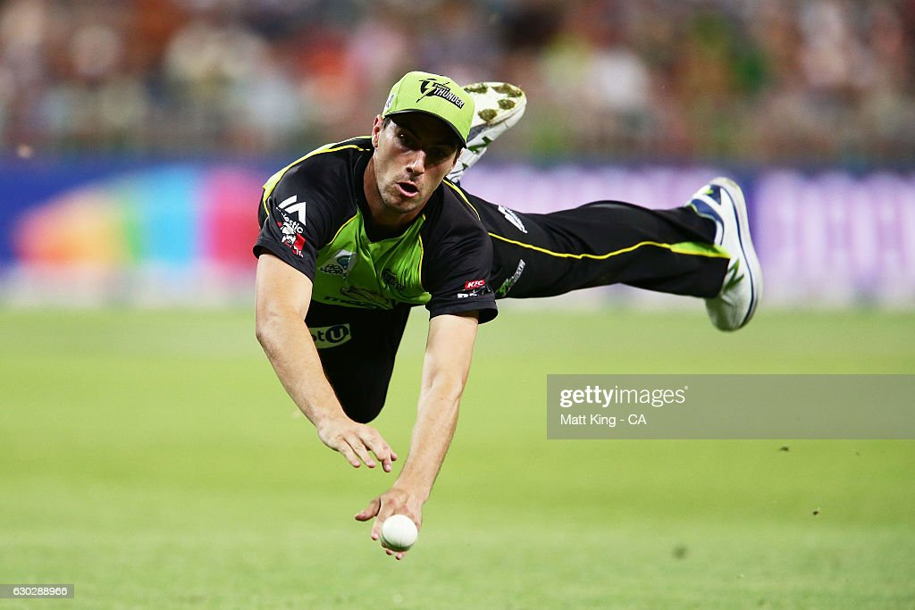 Pat Cummins of the Thunder drops a chance to catch Moises Henriques of the Sixers during the Big Bash League match between the Sydney Thunder and the Sydney Sixers at Spotless Stadium on December 20, 2016 in Sydney, Australia.