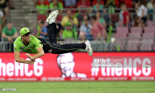 Pat Cummins of the Thunder fields during the Big Bash League match between the Sydney Thunder and Hobart Hurricanes at Spotless Stadium on January 9...
