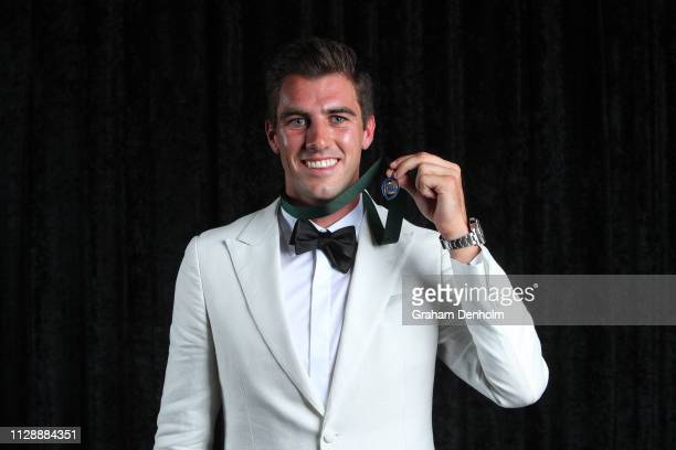 Pat Cummins poses with the Allan Border Medal during the 2019 Australian Cricket Awards at Crown Palladium on February 11, 2019 in Melbourne,...