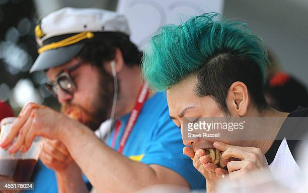 BARRIE ON AUGUST 4 Pat 'Deep Dish' Bertoletti from Chicago and Takeru Kobayashi eat bite for bite Kobayashi defends his pizza eating title at 'Let...