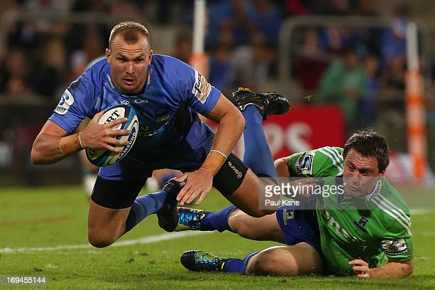 Pat Dellit of the Force gets tackled by Ben Smith of the Highlanders during the round 15 Super Rugby match between the Western Force and the...
