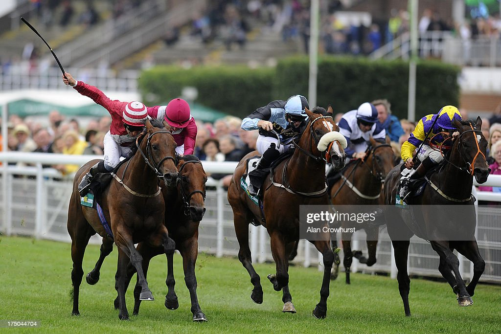 Pat Dobbs riding Brown Sugar (L) win The bet365 Molecomb Stakes at Goodwood racecourse on July 30, 2013 in Chichester, England.