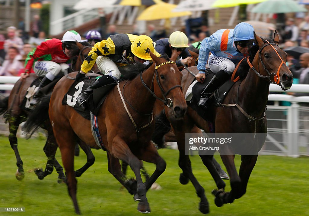 Pat Dobbs riding Forgotten Wish (R) win The Absolute Aesthetics Maiden Fillis' Stakes at Goodwood racecourse on August 29, 2015 in Chichester, England.