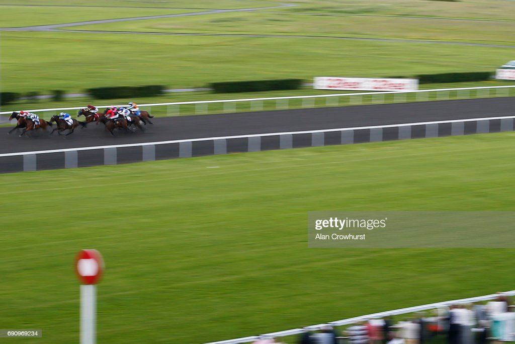 Pat Dobbs riding Ripoll (L) win The 100% profit Boost At 32Redsport.com Handicap Stakes at Kempton racecourse on May 31, 2017 in Sunbury, England.