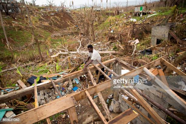 Pat Dorsett rebuilds the roof of his destroyed house in Marigot Dominica on September 28 2017 Hurricane Maria inflicted catastrophic damages and at...
