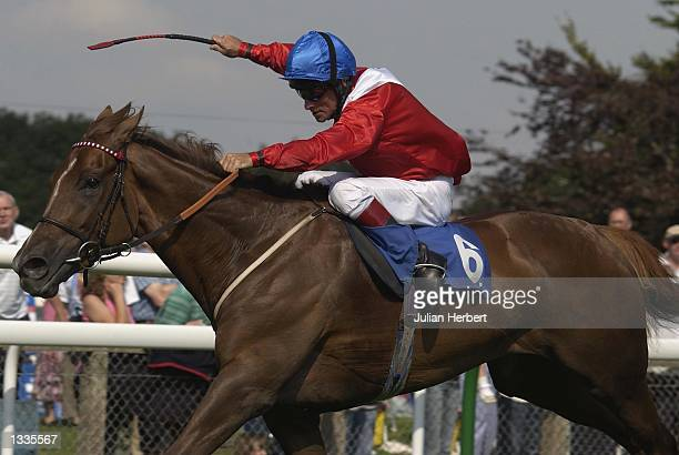 Pat Eddery and Chorist lead the field home to land The EBF Upavon Fillies Stakes run at Salisbury Racecourse in Salisbury on August 14 2002