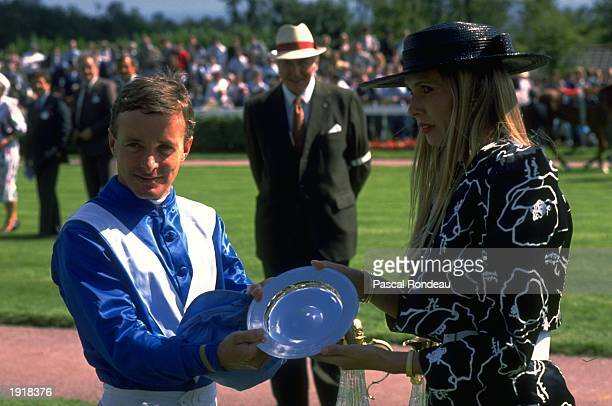 Pat Eddery of Ireland receives the plate after his victory on Warning in the Swettenham Stud Sussex Stakes during Glorious Goodwood at Goodwood...