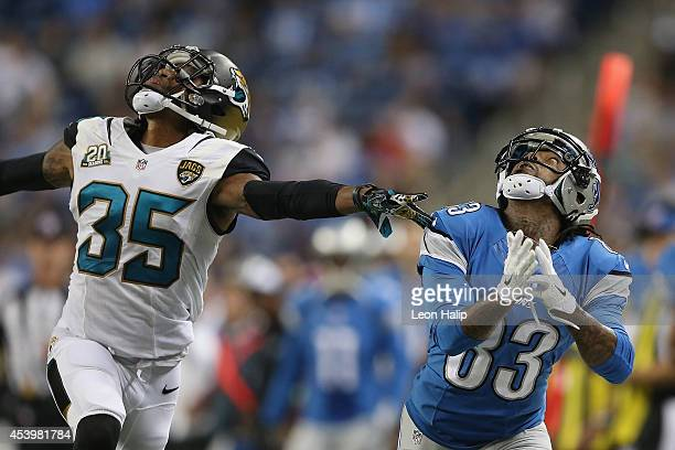 Pat Edwards of the Detroit Lions looks to intercept a pass in the third quarter in front of Demetrius McCray of the Jacksonville Jaguars during a...