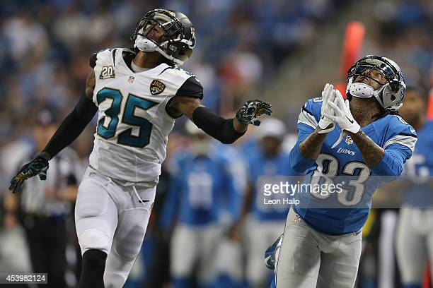Pat Edwards of the Detroit Lions looks to intercept a third quarter touch down pass in front of Demetrius McCray of the Jacksonville Jaguars during a...