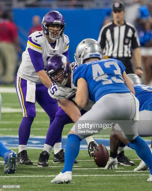 Pat Elflein of the Minnesota Vikings gets set to snap the football to quarterback Case Keenum during an NFL game against the Detroit Lions at Ford...