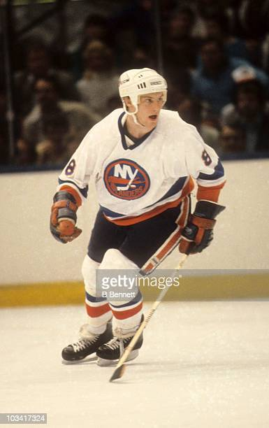 Pat Flatley of the New York Islanders skates on the ice during an NHL game in 1985 at the Nassau Coliseum in Uniondale New York