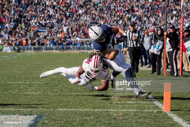 Pat Freiermuth of the Penn State Nittany Lions is tackled by D'Cota Dixon of the Wisconsin Badgers during the first half at Beaver Stadium on...