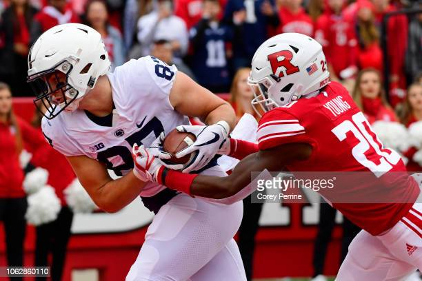 Pat Freiermuth of the Penn State Nittany Lions scores a touchdown against Avery Young of the Rutgers Scarlet Knights during the second quarter at...